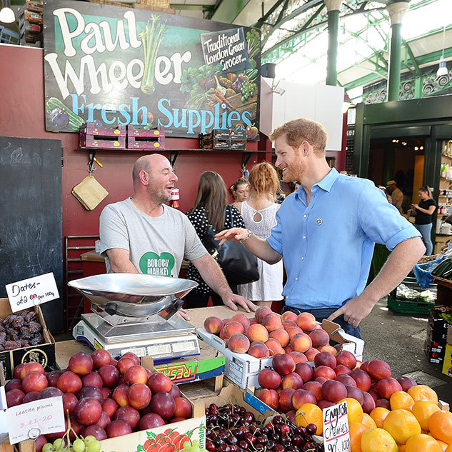 Prince Harry meets stall holder Paul Wheeler, who was sending fruit and veg to the victims of the Grenfell Tower fire, as he tours stalls during a visit to Borough Market.