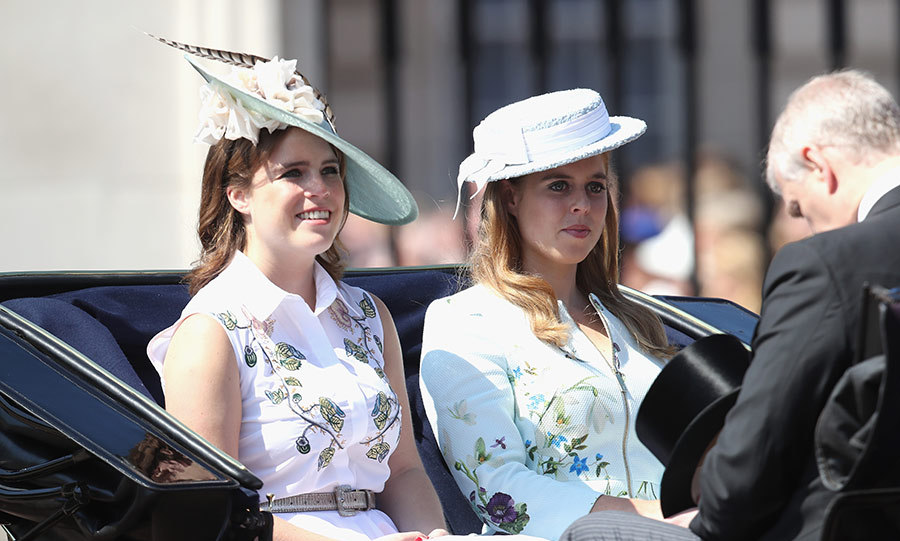 Princesses Beatrice and Eugenie looked elegant wearing similar white, floral outfits and matching hats at the Trooping the Colour parade. The sisters sat in the carriage with their father Prince Andrew as they smiled for crowds at the Queen's birthday celebrations. Beatrice and Eugenie looked happy and relaxed at the annual royal parade.