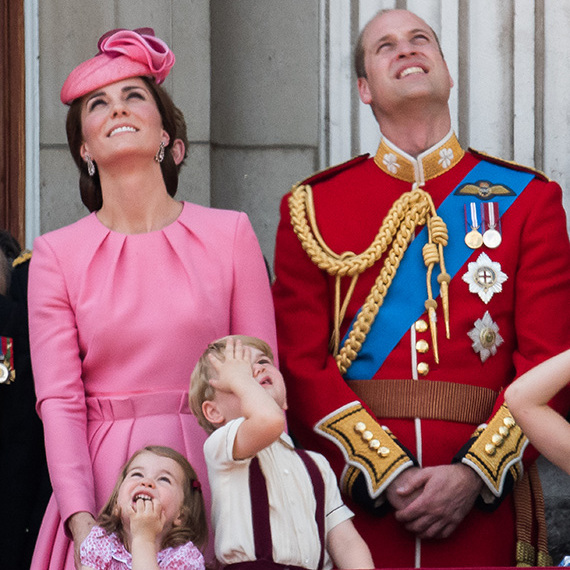 Cute Prince George can't believe his eyes as he watches the RAF flypast from the balcony of Buckingham Palace. Princess Charlotte looked to be having a wonderful time too on the Queen's official birthday.