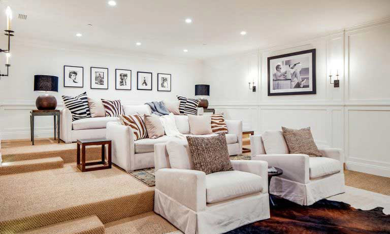 The Buckinghams have added lots of special touches to the new home, including this media room, where residents and any guests will be able to gather to watch films and TV on a large screen. The room is already fitted with plush sofas and armchairs, with spotlights and classic black and white film prints lining the walls.