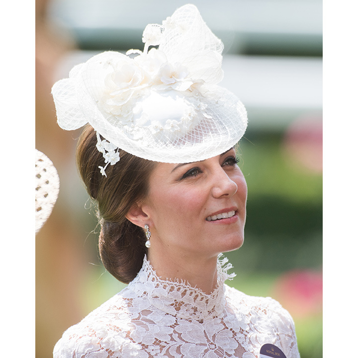 For opening day at Ascot, Kate wore a bespoke pearl adorned hat to complement her lace Alexander McQueen dress. 
