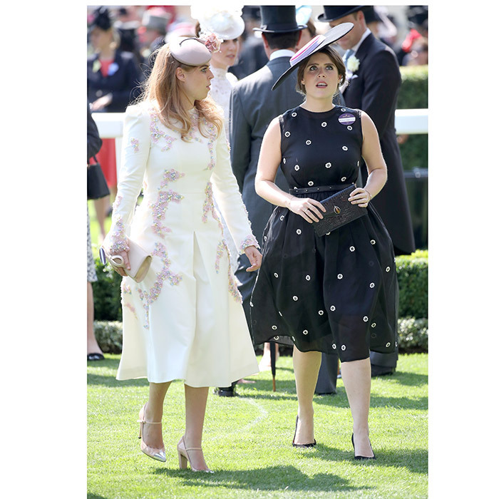 <p>Royal sisters Princess Beatrice, left, and Princess Eugenie wore contrasting looks in cream and navy, respectively.</p>