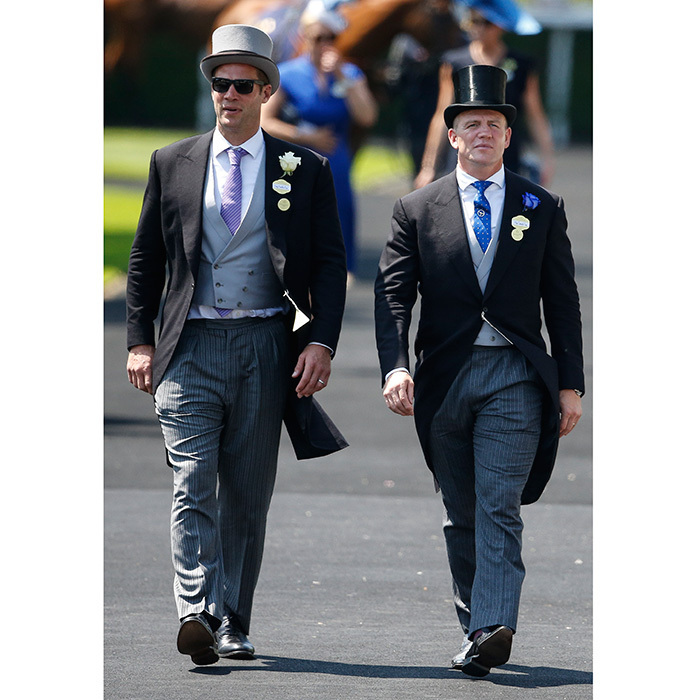 <p>Former pro rugby player Mike Tindall, right – husband of the Queen's granddaughter Zara – rocked a top hat and tails as he made his way through the venue with a friend.</p>