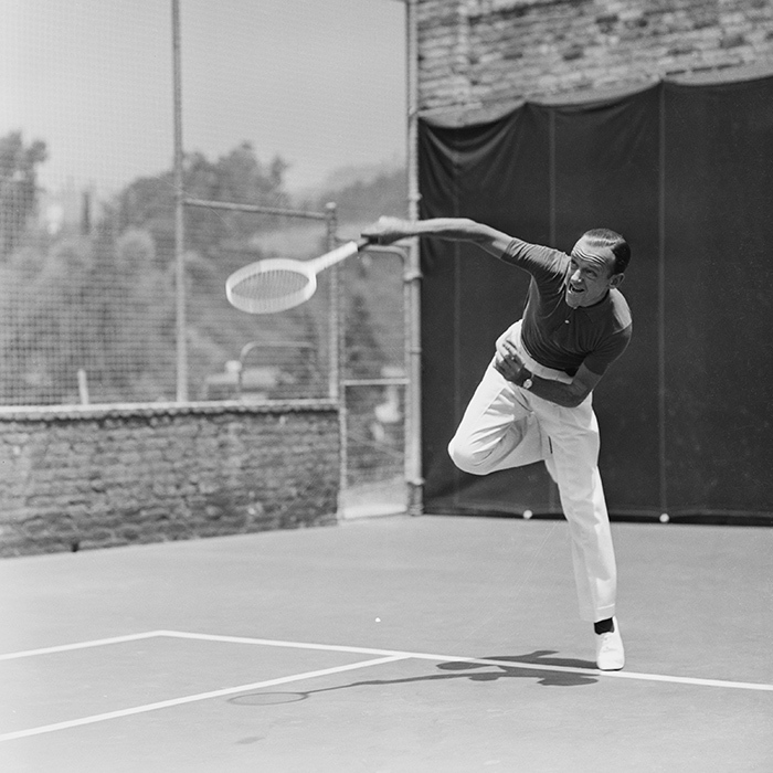 While Fred was known to be a fantastic dancer, fans may be surprised to know that he was also an excellent tennis player. His quick and nimble feet made him a tough opponent to beat. Here he is practising his skills on the court at his Beverly Hills home.