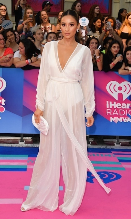 Shay Mitchell floated down the pink carpet in flowing August Getty Atelier at the the 2017 iHeartRADIO MuchMusic Video Awards in Toronto.