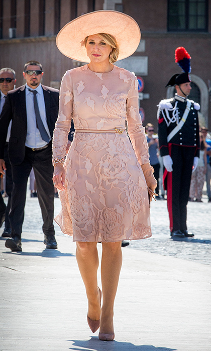 The dutch royal looked pretty in pink for a stroll in Rome.
