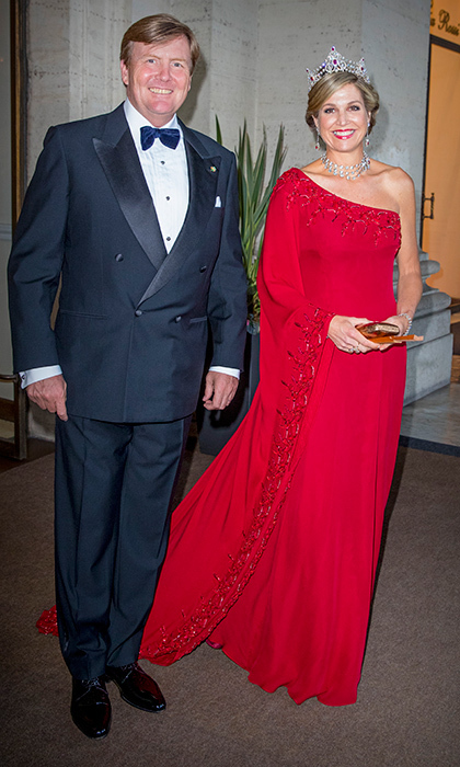 King Willem-Alexander of the Netherlands wore black tie and his wife Queen Maxima was stunning in red and a ruby tiara at an official state banquet at the Palazzo del Quirinale on June 20 in Rome.