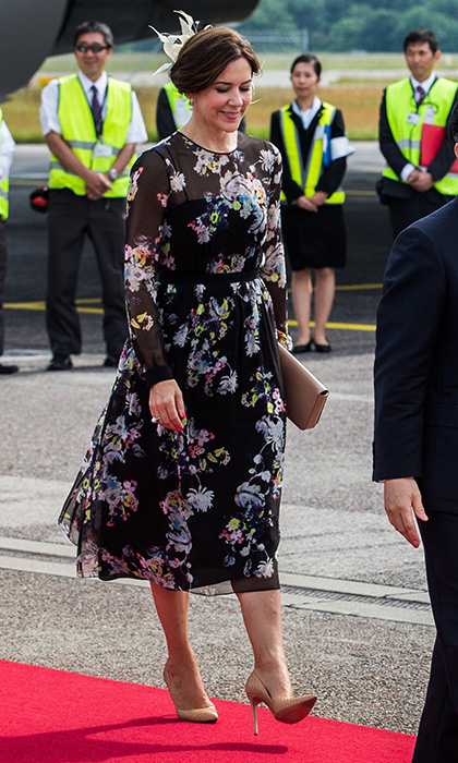 Princess Mary opted for dark florals to greet Japan's Crown Prince Nahurito at Copenhagen Airport on June 15.