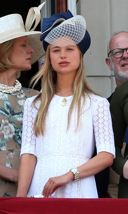 Royal and model Lady Amelia Windsor wore a short sleeved dress and veiled hat as she stepped out onto the balcony at Buckingham Palace for Trooping the Colour.
