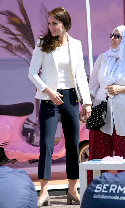 Duchess Kate swapped her designer clothes for a Zara blazer at the 1851 Trust roadshow at Docklands Sailing and Watersports Centre in London on June 16.