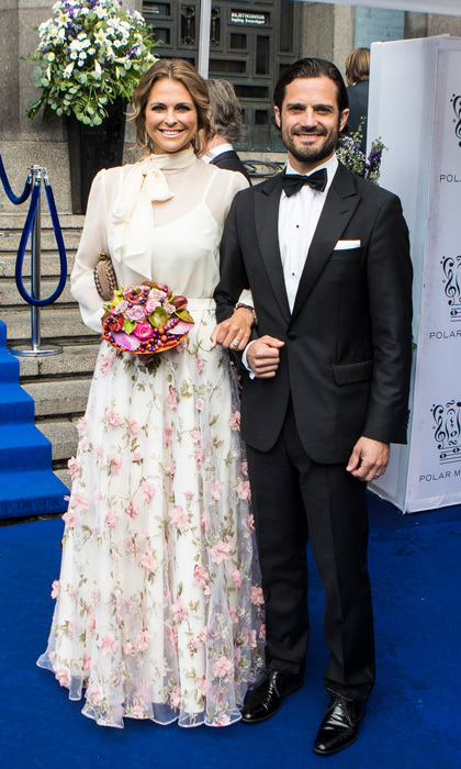 Princess Madeleine wore an ethereal white gown by Ida Sjöstedt that featured 3D floral embellishments to a gala in Sweden.