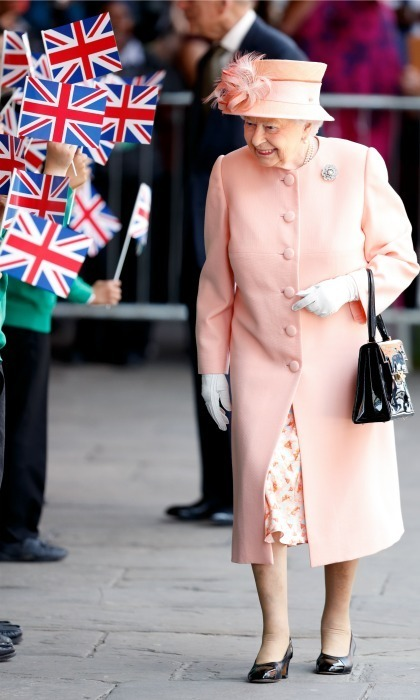 The Queen looked just peachy in her uniformed coat, dress and hat, with her signature black shoes, for her arrival to the Slough Railway Station.
