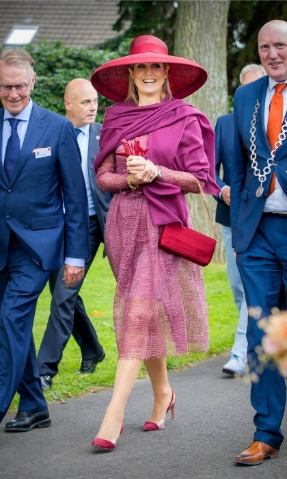 Queen Maxima was dressed for the occasion in head-to-toe fuchsia during the Dutch Rose Association Symposium.