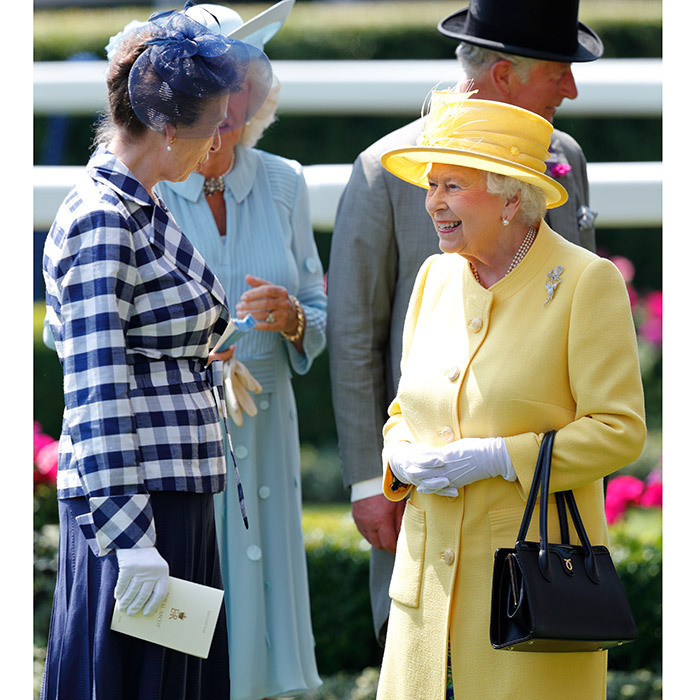 Day two was a busy one for 91-year-old Queen Elizabeth, who attended the State Opening of Parliament as well as Royal Ascot – both without her husband Prince Philip, who was in the hospital recovering from an infection. Here, the monarch chats with her daughter Princess Anne.