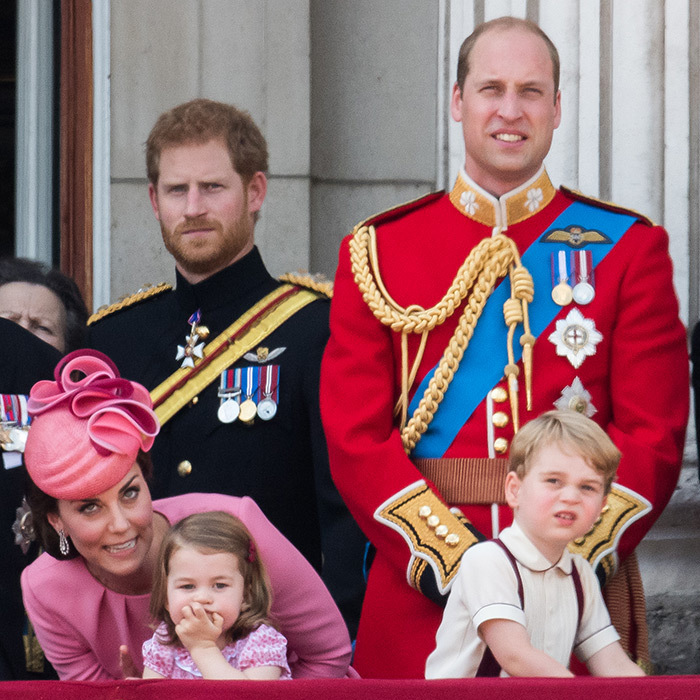As the royal men – Prince Harry, Prince William and Prince George – looked on, Duchess Kate whispered to little Princess Charlotte during Trooping the Colour. 