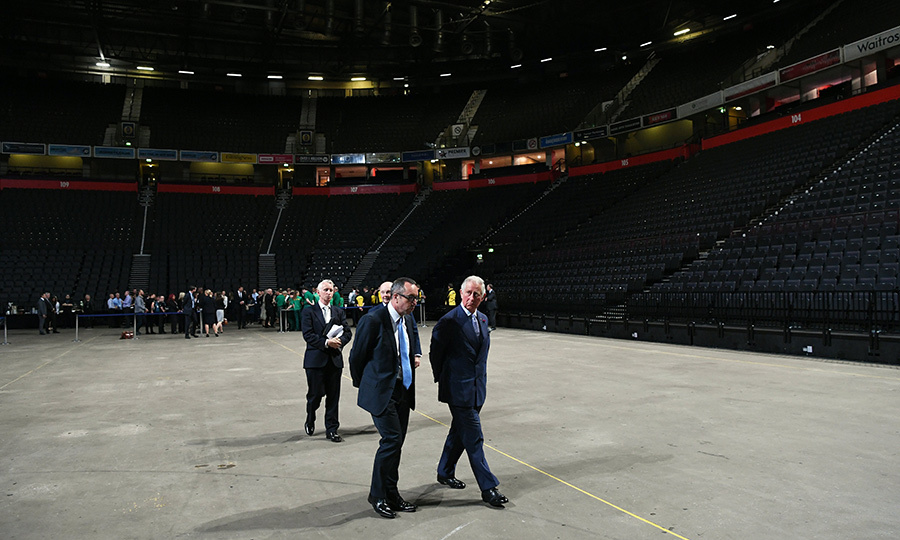 Prince Charles walks around Manchester Arena after meeting with staff who helped the victims of the May 22 bomb attack.