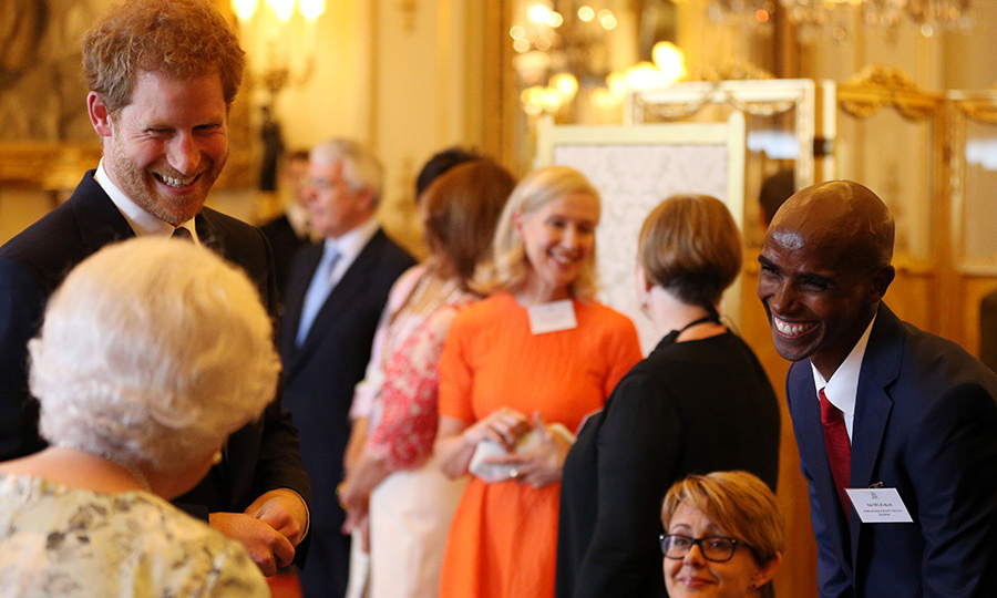 On June 29, the Queen shared a laugh with her grandson Prince Harry and British Olympian Mo Farrah at the 2017 Queen's Young Leaders Awards Ceremony at Buckingham Palace. 