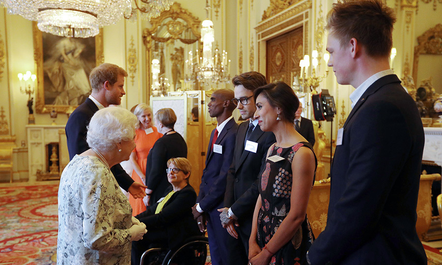 New dad Liam Payne (centre) chatted with the Queen during the reception.
