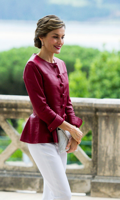 For her visit to opening of the Botin Center in Santander on June 23, the Spanish royal wore a peplum red leather jacket. Queen Letizia paired her look with white pants and a white clutch. 
