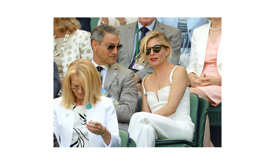 "<p><strong><a href=""/tags/0/sienna-miller"">Sienna Miller's</a></strong> retro-inspired all-white ensemble turned heads at Wimbledon back in 2015, which she teamed with a pair of black shades. A vibrant red lip completed her outfit.</p>