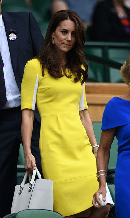 "<p><strong><a href=""/tags/0/kate-middleton"">The Duchess of Cambridge</a></strong> ensured all eyes were on her in a vibrant yellow Roksanda dress back in 2016. The midi-design featured contrasting white panels and was teamed with a dove grey bag.</p>