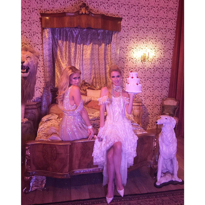 """It's a revolution! #HappyBirthdayPavlos+Olympia,"" Nicky Hilton captioned a photo from the party with her sister Paris.