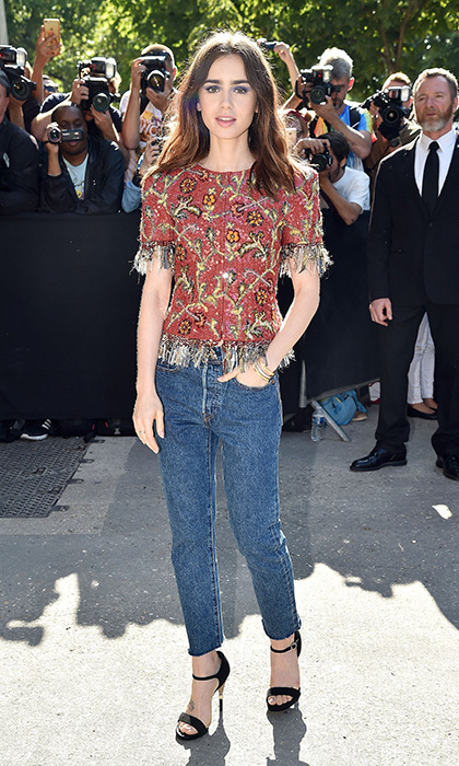 Lily Collins wore a classic denim + heels + Chanel jacket combo for the French label's haute couture presentation.
