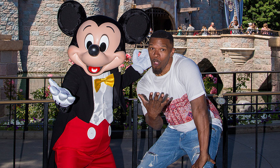 Jamie Foxx recently caught up with his friend Mickey Mouse outside Sleeping Beauty's Castle at Disneyland park in Anaheim, California.