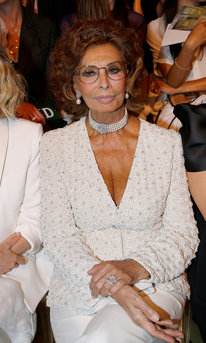 Screen legend Sophia Loren, 82, looked stunning in all white at the Armani presentation. 