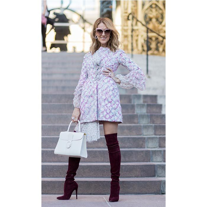 Celine showed off her killer style in a a blue and pink printed dress, white handbag, oversized sunglasses, and red over-the-knee boots at the Giambattista Valli show  Paris Haute Couture Fashion Week.