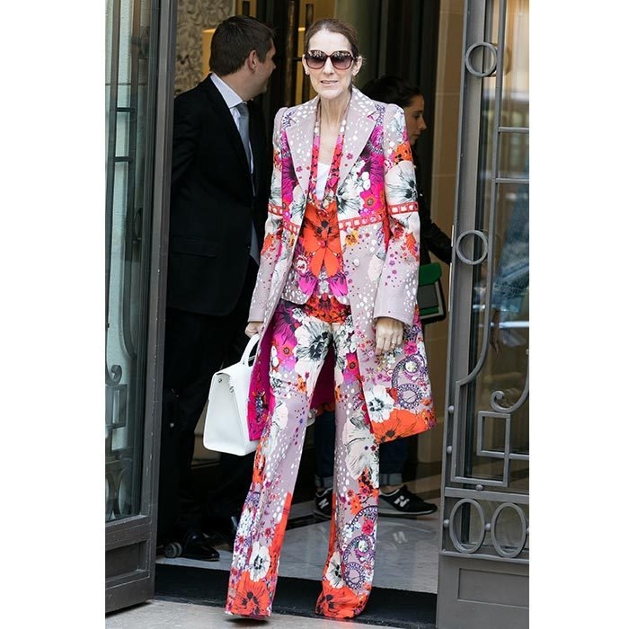 "The ""My Heart Will Go On"" singer turned heads for all the right reasons on June 14 in an eye-popping multi-coloured floral Roberto Cavalli trench coat, blazer and wide-leg pants.