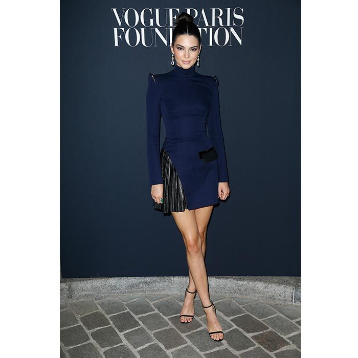 Kendall Jenner showed off her killer legs in a dark blue Mugler dress.