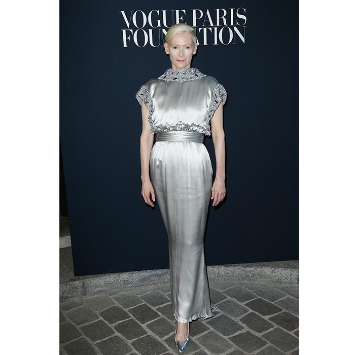 Also at the Vogue dinner, actress Tilda Swinton shined in a decorative silver Chanel dress. 