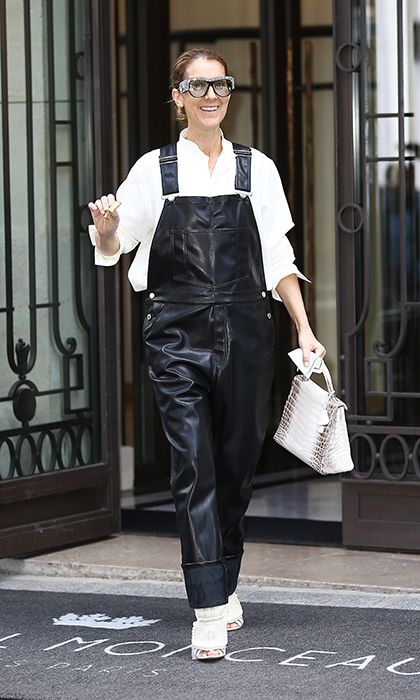 The GRAMMY winner was all smiles as she showed off her faux-leather Givenchy overalls and cream Kanye West x Giuseppe Zanotti pearl encrusted shoes. 