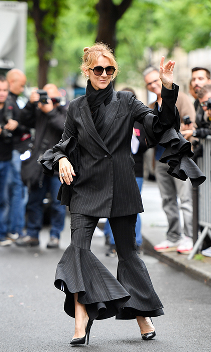 The mother of three wowed fans and photographers in a black and white pinstriped ruffled suit. 