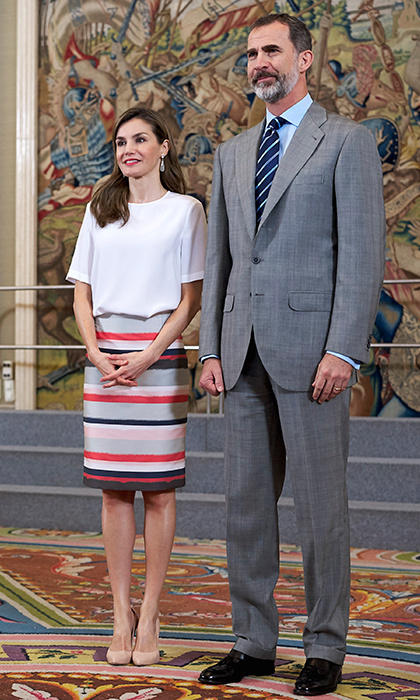 Queen Letizia paired her classic white tee with a chic grey, red and black striped skirt for engagements at Zarzuela Palace on July 5.