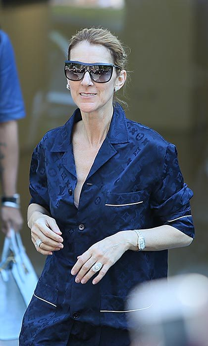 Celine can pull of anything! Here, the French Canadian star shows off her Louis Vuitton x Supreme pajamas. 