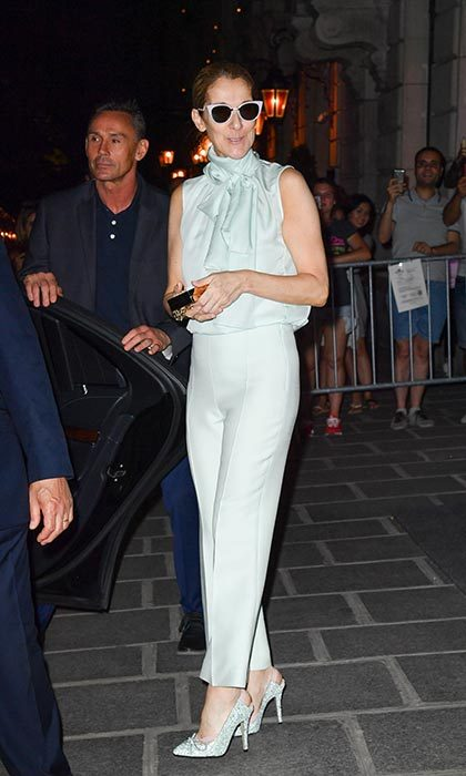 The 49-year-old looked Parisian cool in a mint green top and matching pants during a night out in the City of Light on July 4.