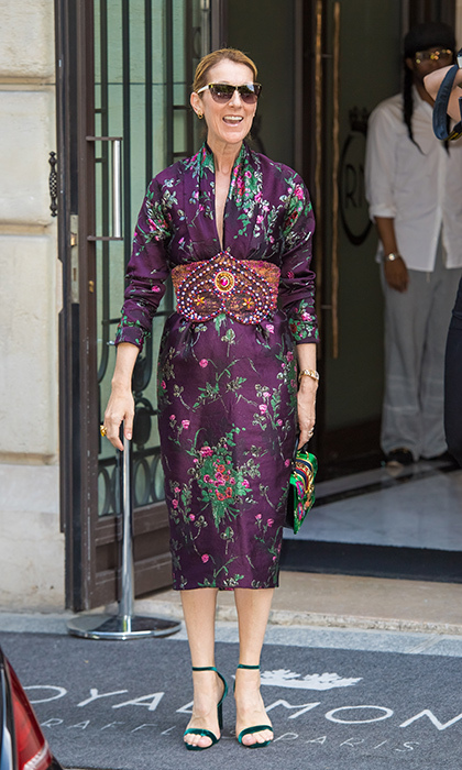 Another day in Paris calls for a little Reem Acra. Celine slipped into a purple floral patterned kimono-inspired dress by the Lebanese designer for an outing on July 5. She completed the look with a large embellished belt, green sandals and matching bag.