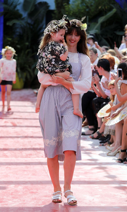 "Coco Rocha's adorable two-year-old daughter Ioni Conran made her runway debut for Bonpoint. The adorable toddler was carried in the arms of a model as she wore a floral dress and a flower crown. The proud mom told WWD, ""She's literally loving life, saying 'I'm gonna be in the show, I'm gonna be in the show,' and I say, 'I know, I booked you for it.'""