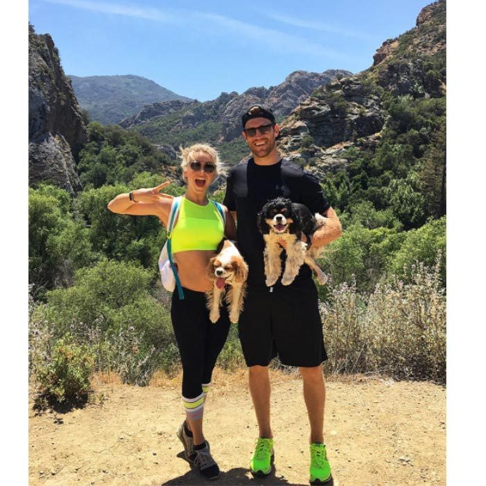 The couple that exercises together stays together! Brooks, Julianne and their adorable dogs, Lexi and Harley, hit the hiking trail in California.