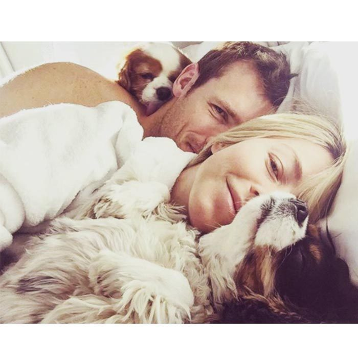Early morning snuggles with your partner are the best! Brooks cuddles with Julianne and their pups. 