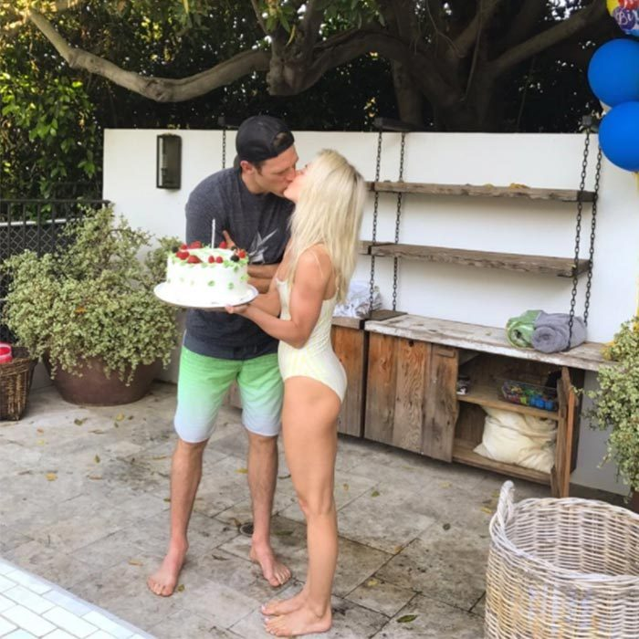 Weeks before walking down the aisle, Julianne threw her future husband an epic pool party for his 34th birthday. We're not sure what's sweeter, their adorable smooch or Brooks' elaborate cake. 