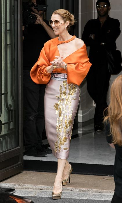 Celine stepped out in a gorgeous orange Bibhu Mohapatra blouse and a pink skirt with gold embellishments on July 8 in Paris.
