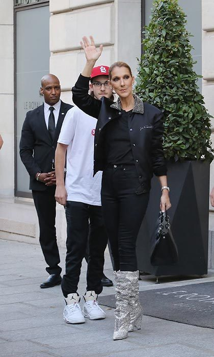 "Fans caught a glimpse of the superstar wearing a Saint Laurent black satin ""je t'aime"" bomber style jacket, black skinny jeans and show-stopping Swarovski Crystal embellished slouchy boots while leaving her hotel in Paris with her son René-Charles on July 7. 