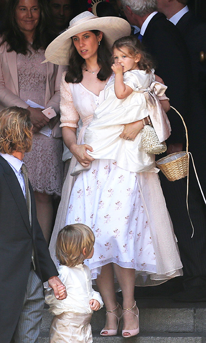 Tatiana Casiraghi wore a ladylike 1950s style skirt and wide-brimmed hat to the ceremony, carrying daughter India in her arms. 