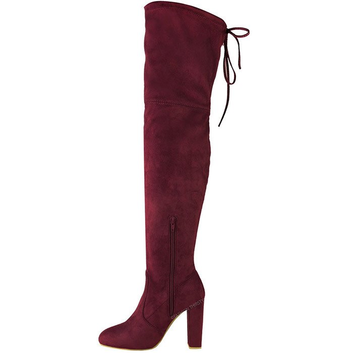 <p><strong>Fashion Thirsty Women's Thigh High Boots Over the Knee Party Stretch Block Mid Heel Size</strong>, $47, <em>amazon.ca</em></p>