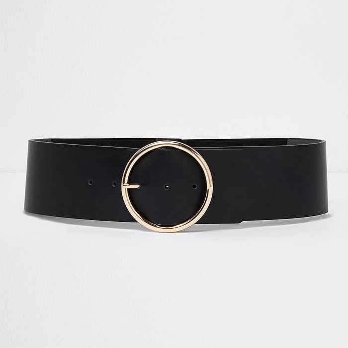 <p><strong>Black Round Buckle Elasticated Waist Belt</strong>, $47, <em>riverisland.com</em></p>