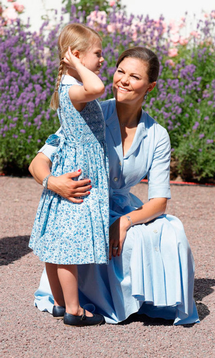 Estelle shared a tender moment with her mother as they matched in baby blue.