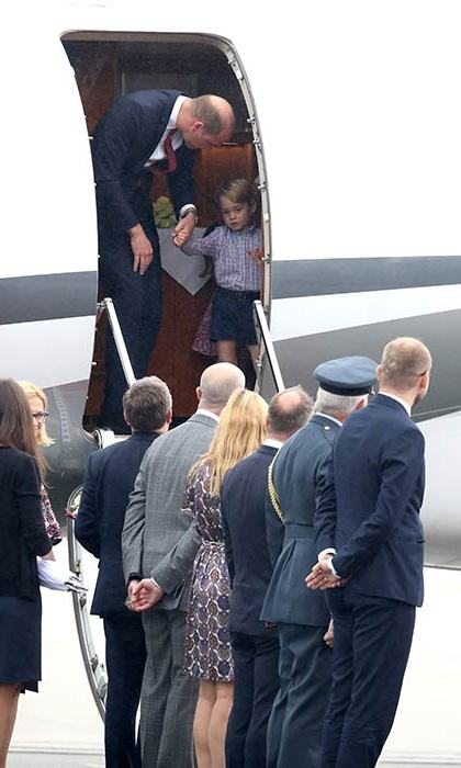 Prince George seemed reluctant to disembark from the plane at first as he arrived in Poland for the family's royal tour.
